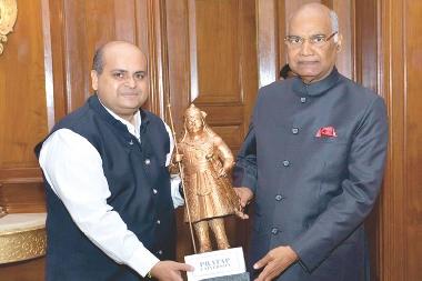 Chairman Pratap University presenting memento to Honble President of India Sri Ramnath Kovind